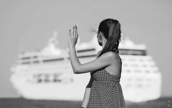 woman-waving-to-ship (1)